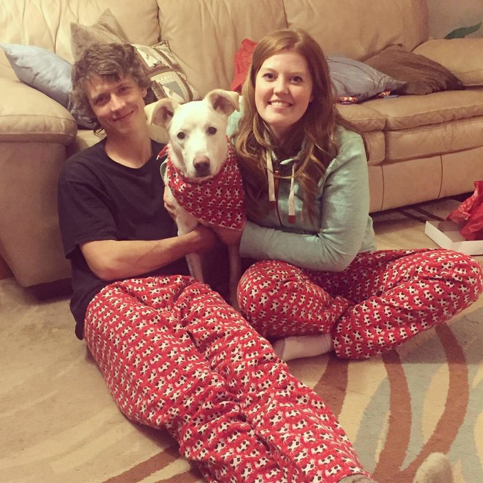 25-year-old Leann with her boyfriend and their dog. Unconditional love despite having an excessive sweating condition.