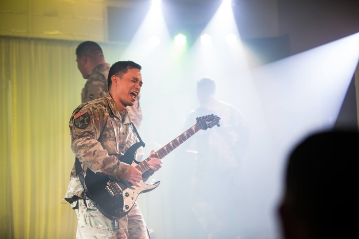 Kenneth playing guitar in the US Army band