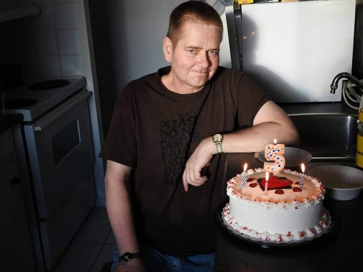 Mike posing with birthday cake